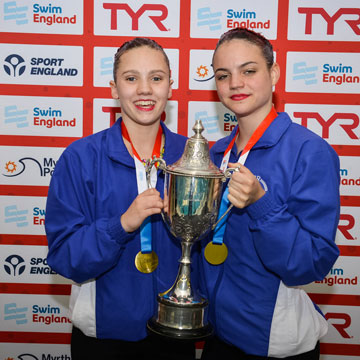 Cerys Larsen and Isobel Blinkhorn hold the Spencer Trophy